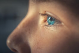 Close-up profile of child with focus on eye.