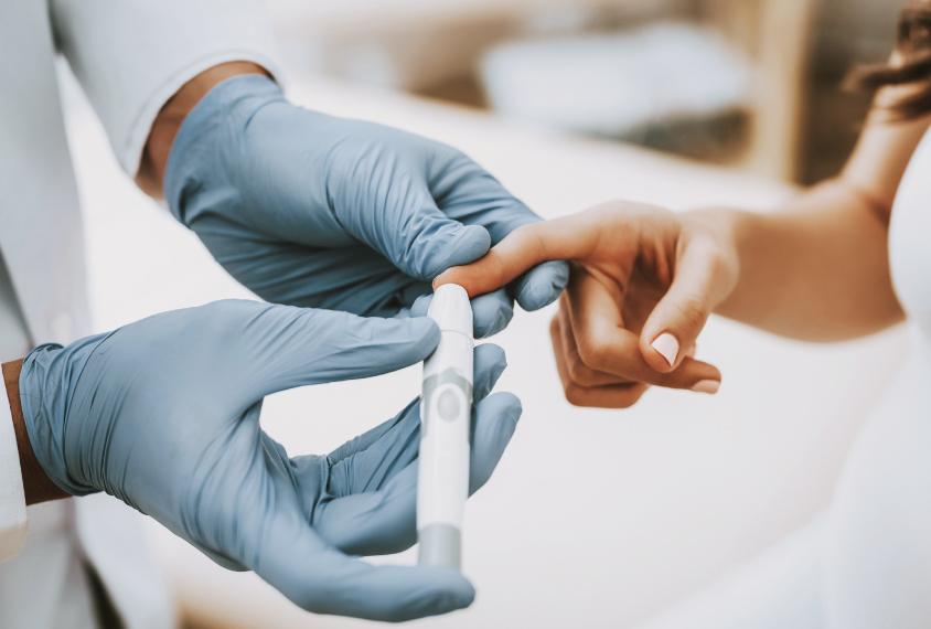pregnant woman having blood test taken from finger