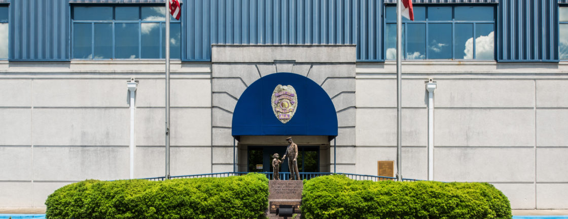 Front of Police station, a statue shows a police officer interacting with a child.
