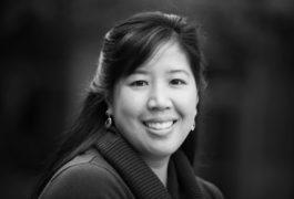 Black and white portrait of Christine Nordhal smiling.