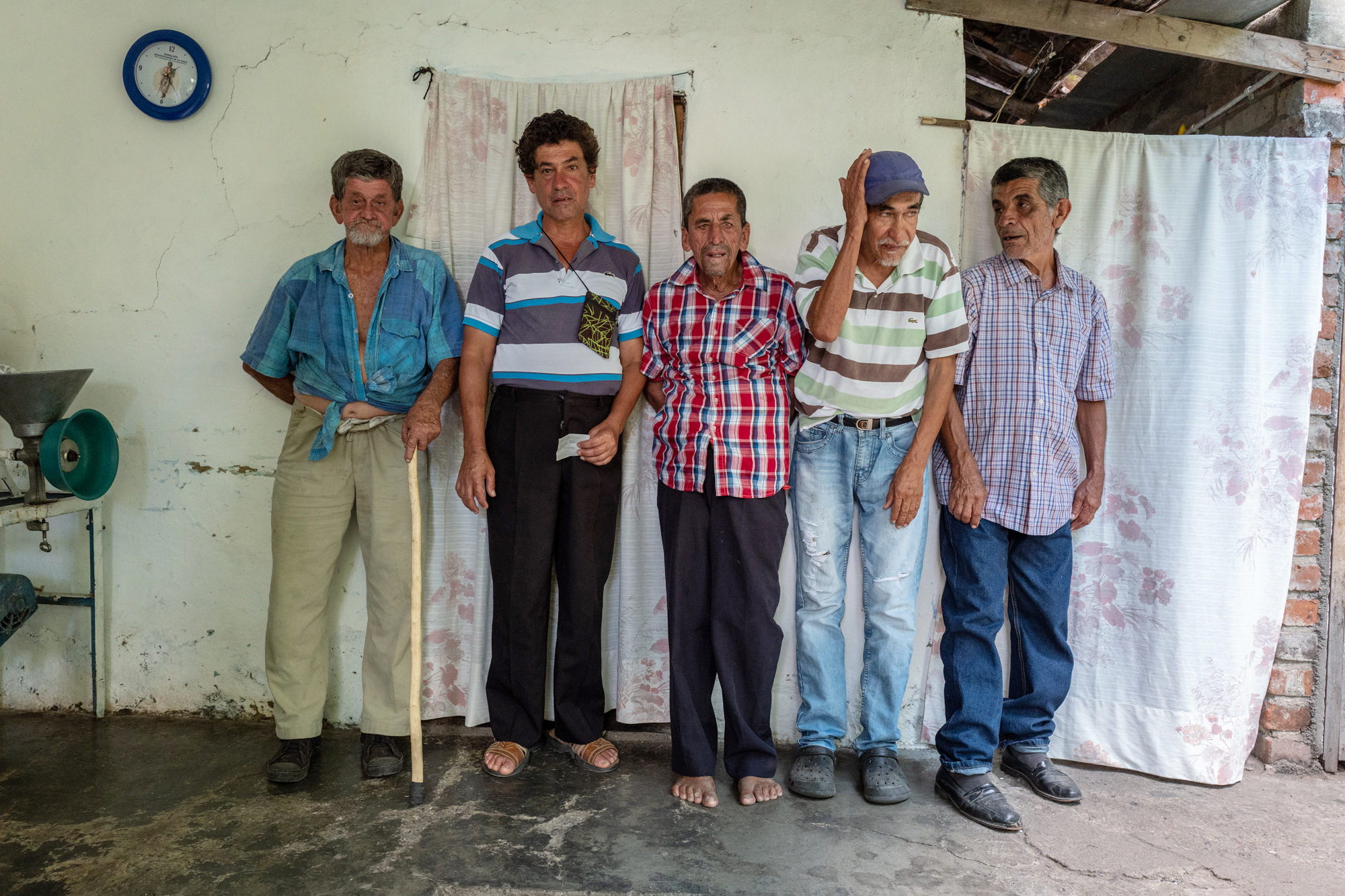 Group of men pose for a portrait.