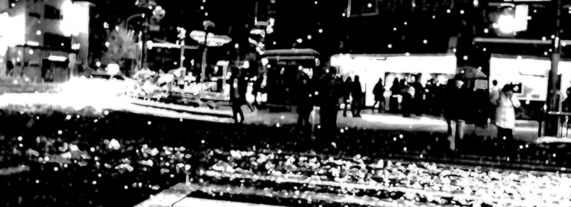 Black and white street scene with high contrast and fragmentation to show possible experience of person with autism.