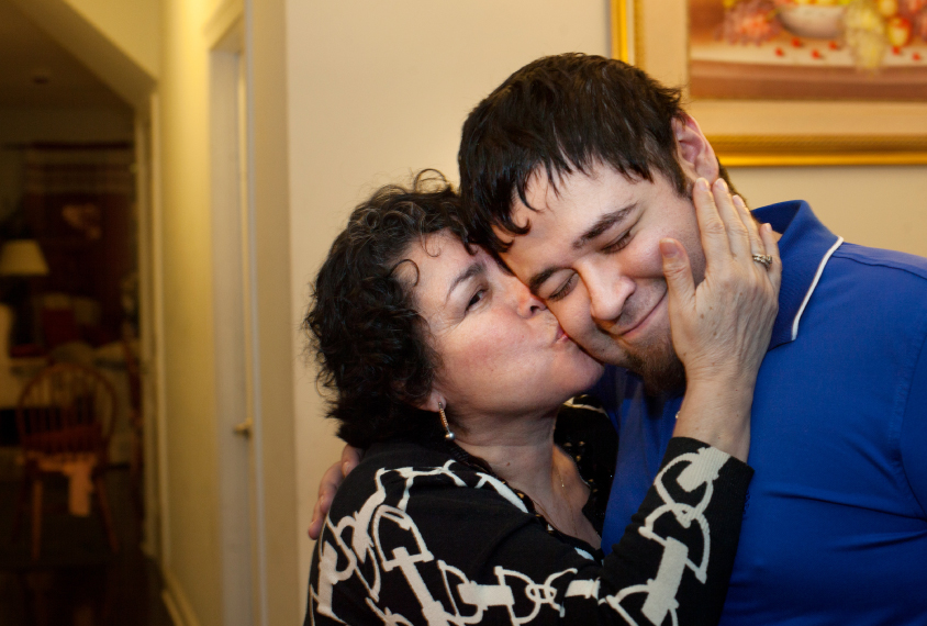 Matie Ovalle kisses her son Carlos's cheek.