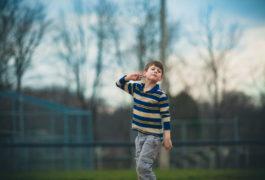 an autistic boy in a field
