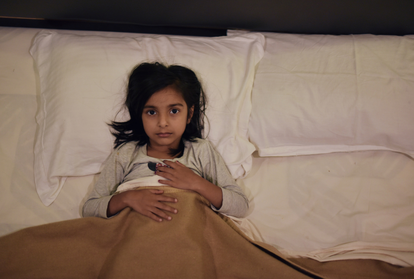 Young girl sleeping in the bed