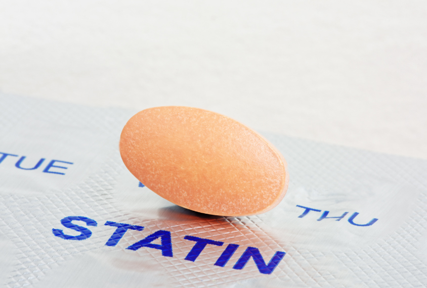 Statin pill rests on blister pack