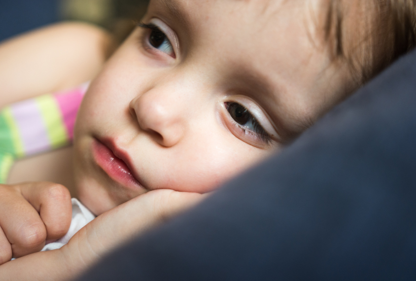 Little girl lying awake