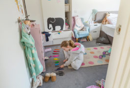 Child is organizing her toys in her room