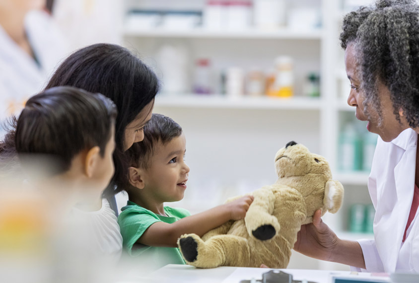 clinician with child and family