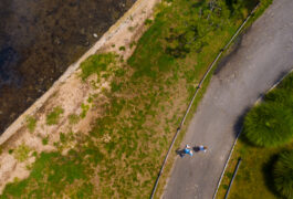Photograph taken by drone shows Anthony ZAdor and his son running alongside the water.