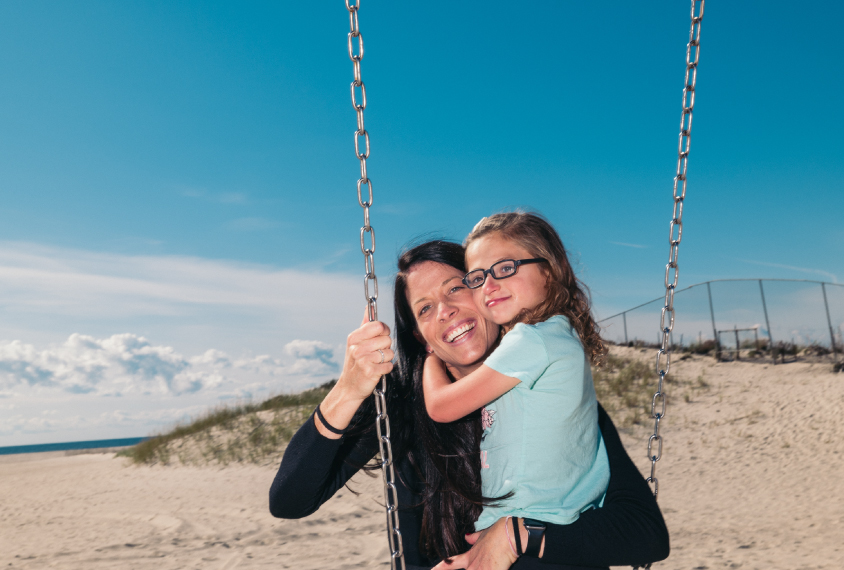 Allyson Berent, and her daughter, Quincy, age 6, on the swings near their home in Altantic Beach, NY.