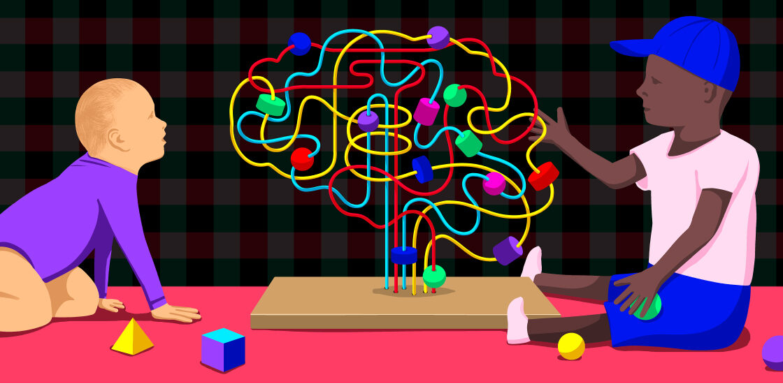 Two children are interacting with a toy in the shape of a brain.