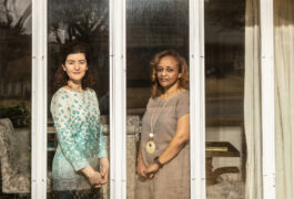 Maria Chahrour and Leah Seyoum-Tesfa framed by a window at Maria's home.