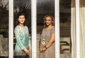 Maria Chahrour and Leah Seyoum-Tesfa framed by a window at Maria's home.