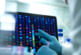Genetic sequencing on computer screen in lab setting.