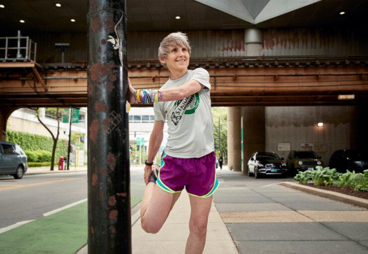 Dr. Elizabeth Berry-Kravis stretching during a run.