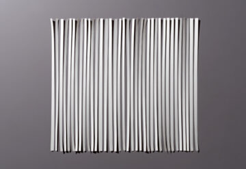 A sheet of paper cut into shreds, and then re-aligned into its original shape.