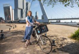 Portrait of Tonya White with her bike next to the water, Rotterdam.