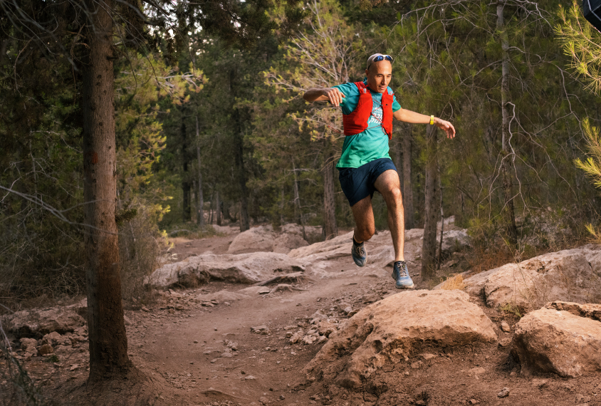Ofer Yizhar jumps during a trail run.