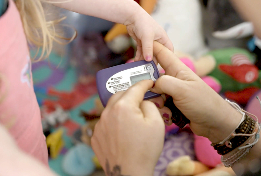Mom and toddler with audio recording device