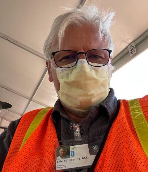 Eric Fombonne headshot wearing surgical face mask.