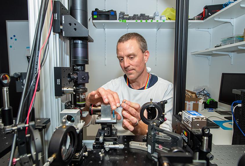 Scientist Ethan Scott in his lab.