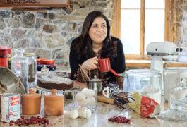 Mayada Elsabbagh portrait in her messy kitchen, drinking coffee.